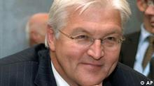 Germany's Foreign Minister Frank-Walter Steinmeier smiles at the start of the Foreign Ministers meeting in Luxembourg, Monday Oct. 16, 2006. European Union foreign ministers were to press Serbia on Monday to live up to international demands it hunt down and hand over top war crimes suspect Ratko Mladic to the U.N. war crimes tribunal. (AP Photo/Nicolas Bouvy)