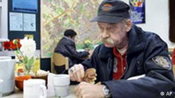 Soup kitchen - homeless man eating