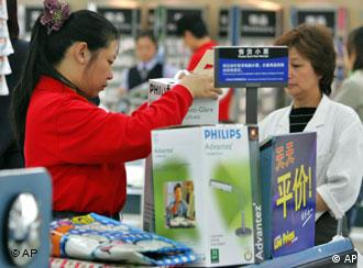 FILE ** A Chinese cashier rings up products being purchased by a Chinese customer in one of the Chinese outlets of the American supermarket Wal-Mart in Beijing, China, in this Oct. 12, 2006, file photo. Wal-Mart Stores Inc. is bidding about $1 billion (euro800 million) for a chain of 100 hypermarkets in China in a deal that could vault it ahead of competitors to become the country's biggest food and department store network. (AP Photo/Elizabeth Dalziel/File)