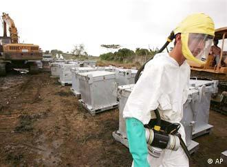 A man wearing a protective suit at the site where toxic waste was dumped