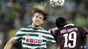 Bayern's Julio Dos Santos, right, jumps for the ball with Sporting's Miguel Veloso