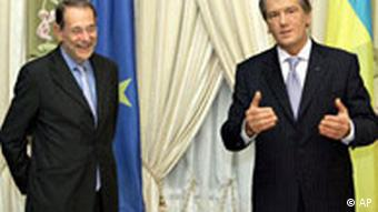 European Union's foreign policy chief Javier Solana, left, smiles as he listens to Ukraine's President Viktor Yushchenko, right, in Kiev, Ukraine, Thursday, Oct. 19, 2006.