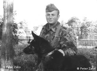 Peter Zahn in uniform with a military dog in the mid-1960s