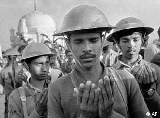 Mukti Bahini soldiers hold their hands out in prayer to Allah before the torture and execution of four men suspected of collaborating with Pakistani militiamen accused of murder, rape and looting during months of civil war. (AP Photo/Horst Faas, Michel Laurent)
