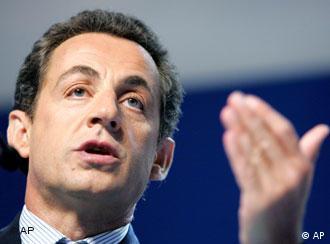 French President Nicolas Sarkozy gesturing