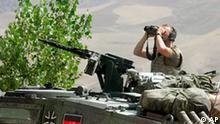 ** ARCHIV ** A Bundeswehrsoldat sitzt am 18. Juli 2006 in der Gegend des Flughafens Feisabad in Afghanistan. Mit Empoerung hat die Fuehrung der Bundeswehr am Mittwoch, 25. Okt. 2006, auf die Veroeffentlichung von makaberen Fotos deutscher Soldaten in Afghanistan reagiert. Die von der Bild-Zeitung abgedruckten Bilder zeigen Soldaten, die mit einem Totenschaedel posieren. (AP Photo/Michael Hanschke, Pool) ** FILE ** A German soldier sitting atop of a tank watches the area around Feisabad Airport in Afghanistan, Tuesday July 18, 2006. (AP Photo/Michael Hanschke, Pool)