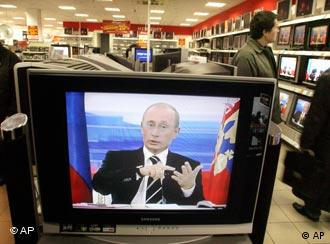 People watch Russian President Vladimir Putin during a nationally televised question-and-answer session