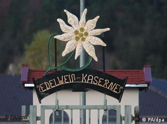 A sculpture of an edelweiss flower adorns the entryway to an elite brigade's camp