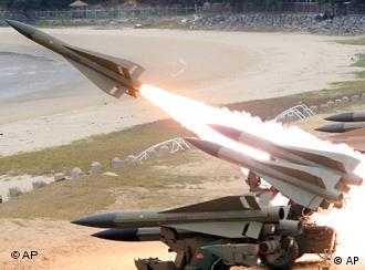A U.S.-made Hawk missile is fired from the launch rail during South Korean Air Force's missile shooting match in Boryoung, south of Seoul, South Korea, Thursday, Oct. 26, 2006. South Korea made its first concrete move Thursday to enforce sanctions over the North's nuclear test, saying it will ban Northern officials who fall under a U.N. travel restriction. (AP Photo/Yonhap, Cho Yong-hak) ** KOREA OUT **