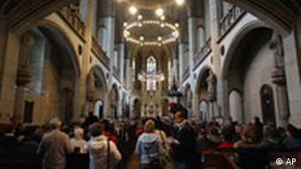 People attend a service on Reformation Day