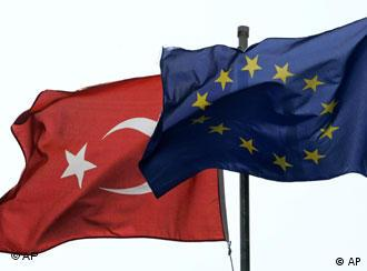 The flags of Turkey, left, and the European Union fly over a building in Istanbul, Turkey, in this Sept. 30, 2005 file photo.