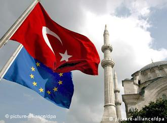A Turkish flag and an EU flag fly in front of the Nur-i Osmaniye Mosque