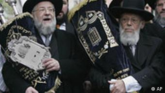 Orthodox Rabbis are carrying the torah in a procession when Munich's Jewish Community Center and synagogue were inaugurated