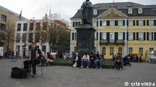 Strassenmusikant auf dem Münsterplatz in Bonn