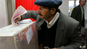 A man casts his ballot in a Georgian-controlled villiage near South Ossetia's capital