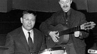 A black and white photo of Biermann and Neuss performing in 1965