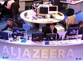 Al Jazeera English Channel staff prepare for the broadcast in Doha news room in Qatar