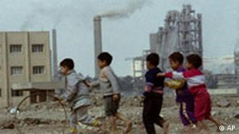 File photo. Children play with a hoop near a cement factory in Cairo, Egypt March 26, 1996.