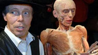 Gunther von Hagens stands with one of his plastinated specimens