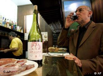 Man drinking a glass of Beaujolais