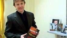 ** FILE ** Alexander Litvinenko, former KGB spy and author of the book Blowing Up Russia: Terror From Within photographed at his home in London in this Friday, May 10, 2002 file photo. Police said Sunday, Nov. 19, 2006 they were investigating the suspected poisoning in London of the former Russian spy and outspoken Kremlin critic who had accused his former colleagues of involvement in terrorism and assassinations. Scotland Yard said it began an investigation on Friday. Col. Alexander Litvinenko, 43, was under armed guard in University College Hospital in London. (AP Photo/Alistair Fuller) (AP Photo/Alistair Fuller)