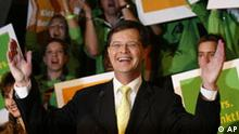 Dutch Prime Minister Jan Peter Balkenende celebrates the parliamentary elections results with his Democratic Party CDA at the Lucent Dance Theater in The Hague, Netherlands, Wednesday Nov 22, 2006. Prime Minister Jan Peter Balkenende's center-right Christian Democrats had a clear lead Wednesday over the leftist Labor Party, early returns suggested _ but not enough for a majority in the next parliament. (AP Photo/Fred Ernst)