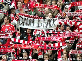 Cologne soccer fans hold a banner reading Daum is Back at a match against 1860 Munich