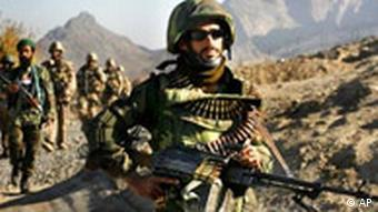 Soldiers from the Afghan National Army, and Canadian soldiers from 3rd Bat, Royal 22nd Regiment of Valcartier, Quebec return from a patrol in the town of Panjwayi in the Kandahar province of Afghanistan Thursday, Nov. 23, 2006.
