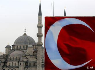 The white crescent of the Turkish flag is seen in front of the New Mosque in Istanbul, Turkey