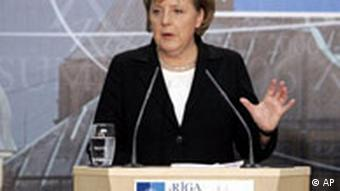 German Chancellor Angela Merkel gestures while speaking during a final media conference after a NATO summit in Riga