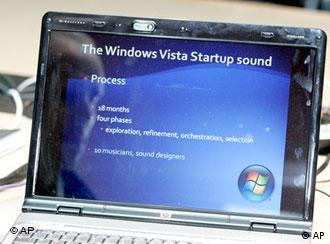 A laptop computer displays information about Windows Vista