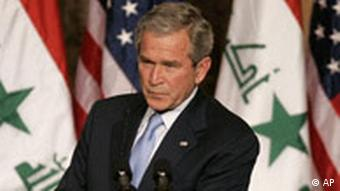 U.S. President George W. Bush pauses during a joint press conference in Jordan