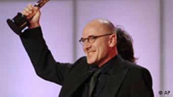 Ulrich Mühe accepting trophy