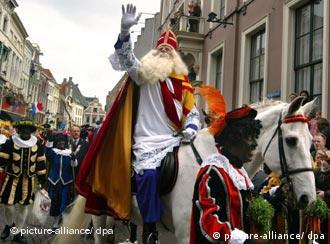 A Sinterklaas parade in 2003 features many of the helpers in black-face