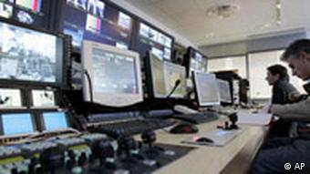 Newsmen work at France 24 Television newsroom in this Nov. 13, 2006 file photo in Paris. France