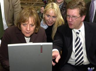 Merkel stares into a computer screen