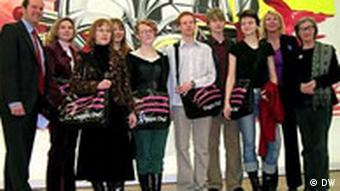 Young artists standing in front of modern paintings at Bonn's Kunst und Ausstellungshalle, a major art museum