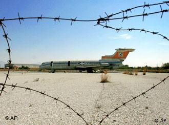 An old Cyprus Airways plane stands behind barbed wire in the buffer zone dividing the Greek and Turkish Cypriot areas of Nicosia