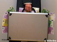 A man holds a suitcase full of money