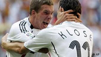 Germany's Lukas Podolski, left, celebrates with his teammate Miroslav Klose, right, after Podolski scored his side's second goal during the Germany v Sweden Round of 16 soccer match at the World Cup stadium in Munich, Germany, Saturday, June 24, 2006.
