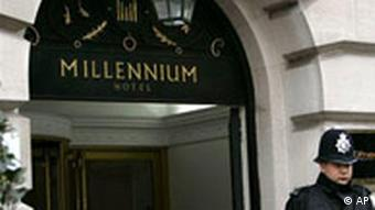A policeman stands in front of the entrance to the Millenium Hotel