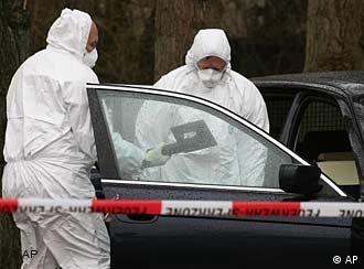 Investigators of the Federal Agency for Radiation Protection examine a BMW car