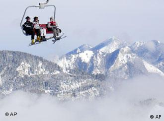 Skiers enjoying snowy mountains