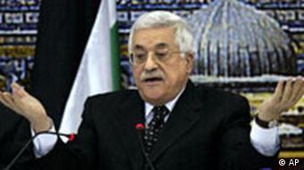 Abbas making a helpless gesture