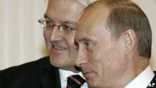 Russian President Vladimir Putin, right, and German Foreign Minister Frank-Walter Steinmeier seen during their meeting in the Kremlin in Moscow, Thursday, Dec. 21, 2006. Germany's foreign minister warned Thursday that the assassinations of two vocal Kremlin critics had the potential to damage Moscow's reputation and urged Russia to help with the investigations into their deaths. (AP Photo/Sergei Karpukhin, Pool)