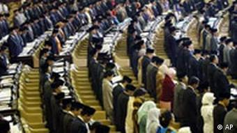 New parliament members stand as they are sworn in, Friday, Oct. 1, 2004, in Jakarta, Indonesia. Indonesia's transition to democracy took a crucial step forward Friday when a new parliament convened with all its lawmakers directly elected to the job, and no seats reserved for the powerful military. (AP Photo/Dita Alangkara)