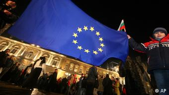 Bulgarian flag being wave at night-time accession celebrations