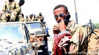 An Ethiopian soldier radios headquarters upon the arrival in the port city of Kismayu after dislodging Islamic fighters from their last remaining stronghold in Somalia on Monday 1 January 2007. Government forces backed by Ethiopian troops took control Somalia's third largest city when soldiers from the Islamic Courts Union abandoned their positions after a night of heavy shelling and advanced with tanks, aircraft and a large contingent of troops. Witnesses report seeing hundreds of Islamic fighters many of them Arabs and South Asians fleeing the town in the direction of neighboring Kenya. Ethiopian troops officially entered Somalia on 24 December, joining fighters loyal to Somalia's interim government, to repel an Islamist assault on the government stronghold of Baidoa. EPA/IBRAHIM ELMI +++(c) dpa - Report+++