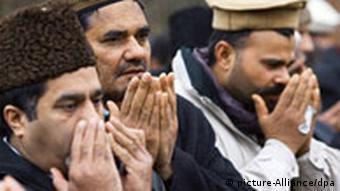 Ahmadiyya muslims pray at the ground-breaking ceremony for the Khadija Mosque