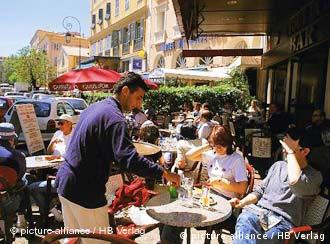 People sitting at a French cafe